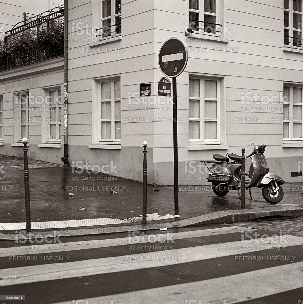 Piaggio Vespa scooter parked in Paris stock photo