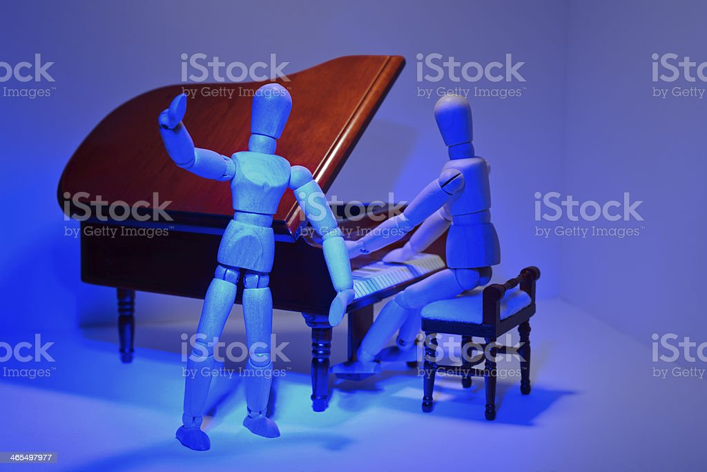 Pianist and singer in the blue stage light royalty-free stock photo