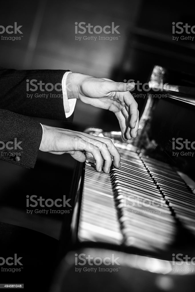 Pianist hands playing black and white stock photo