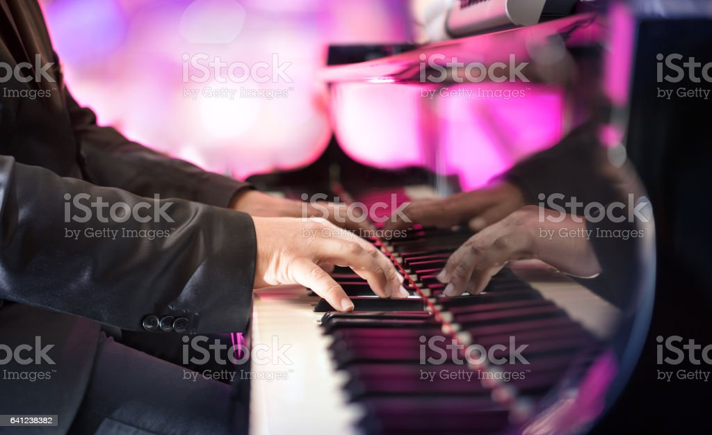 Pianist Playing Grand Piano stock photo