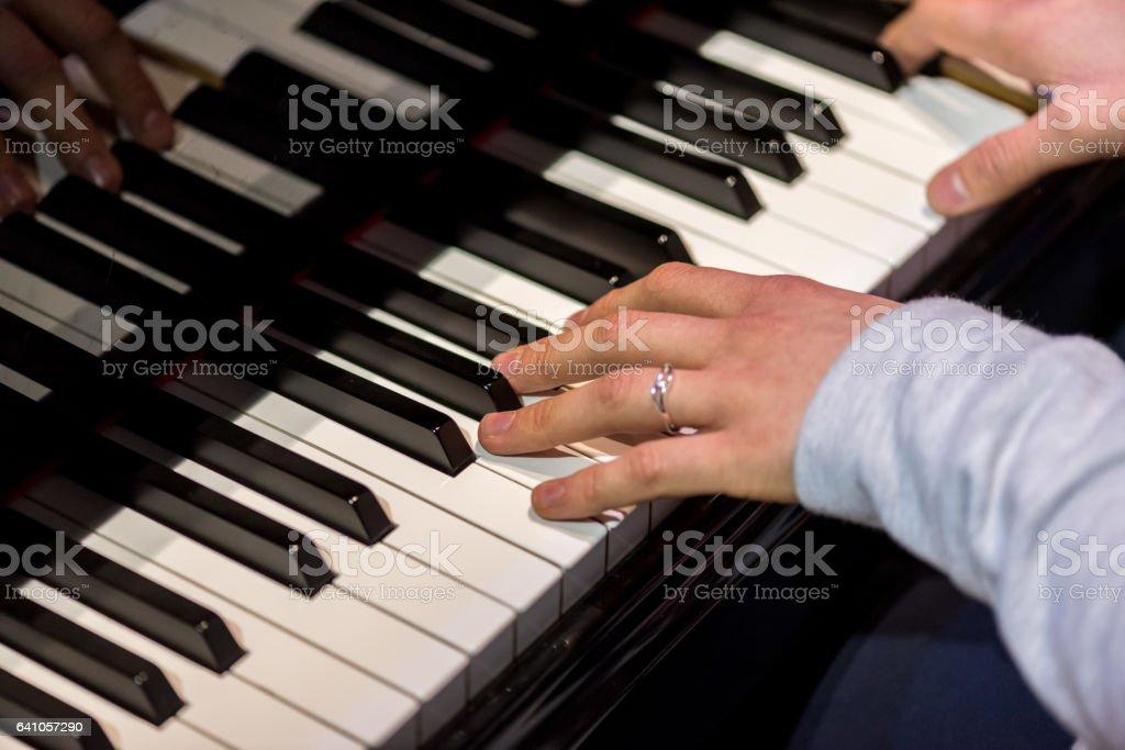 Pianist playing the paino stock photo
