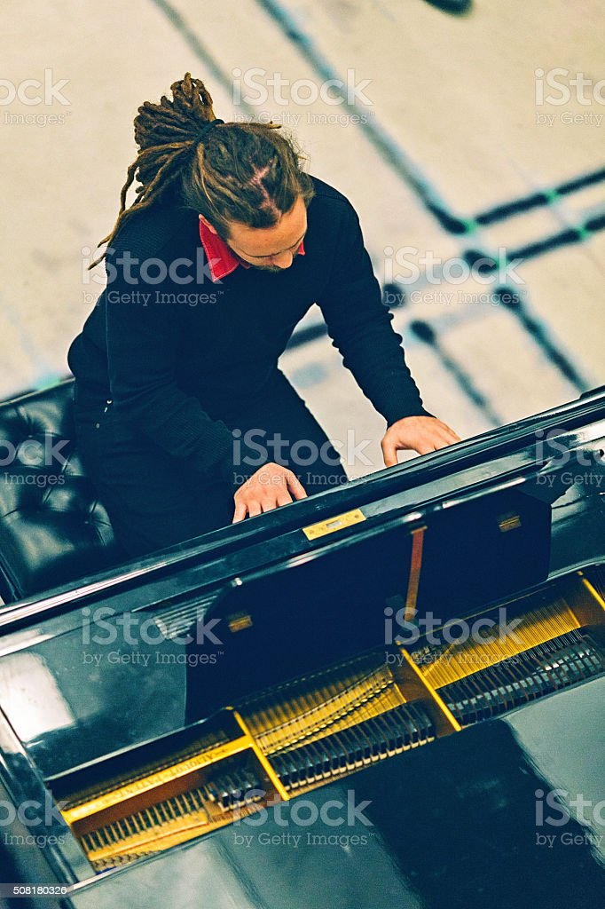 pianist playing the piano stock photo