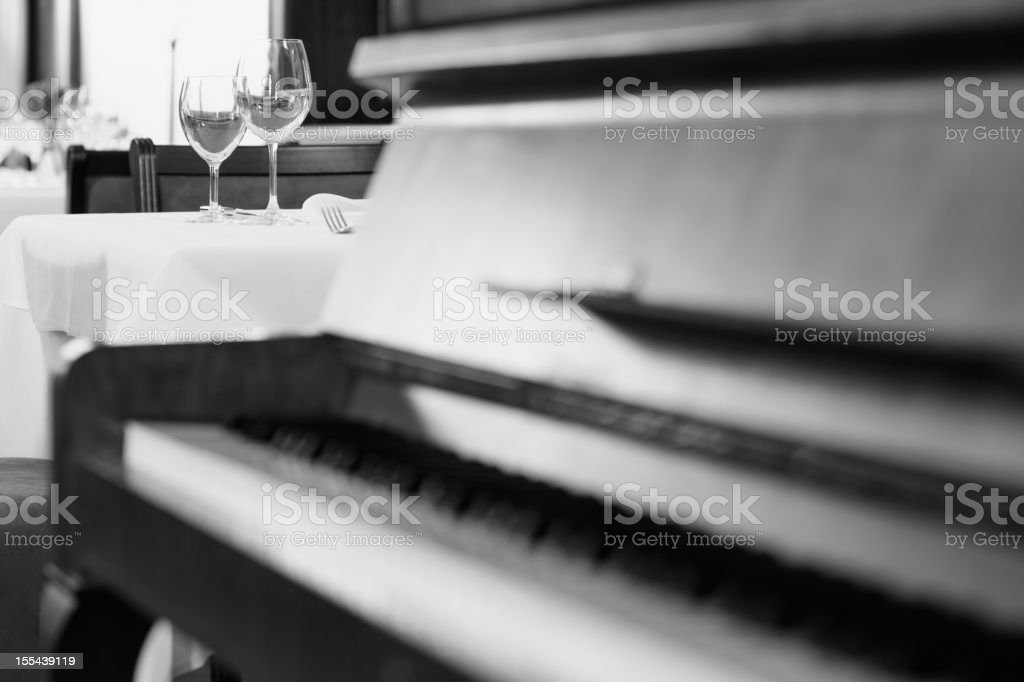 Piano and restaurant stock photo