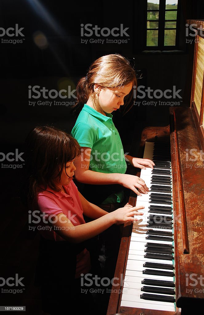 Piano at four hands. stock photo