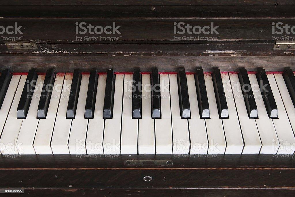 Piano Chipped and Broken, Closeup royalty-free stock photo