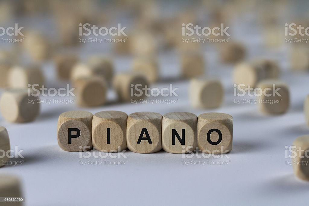 piano - cube with letters, sign with wooden cubes stock photo