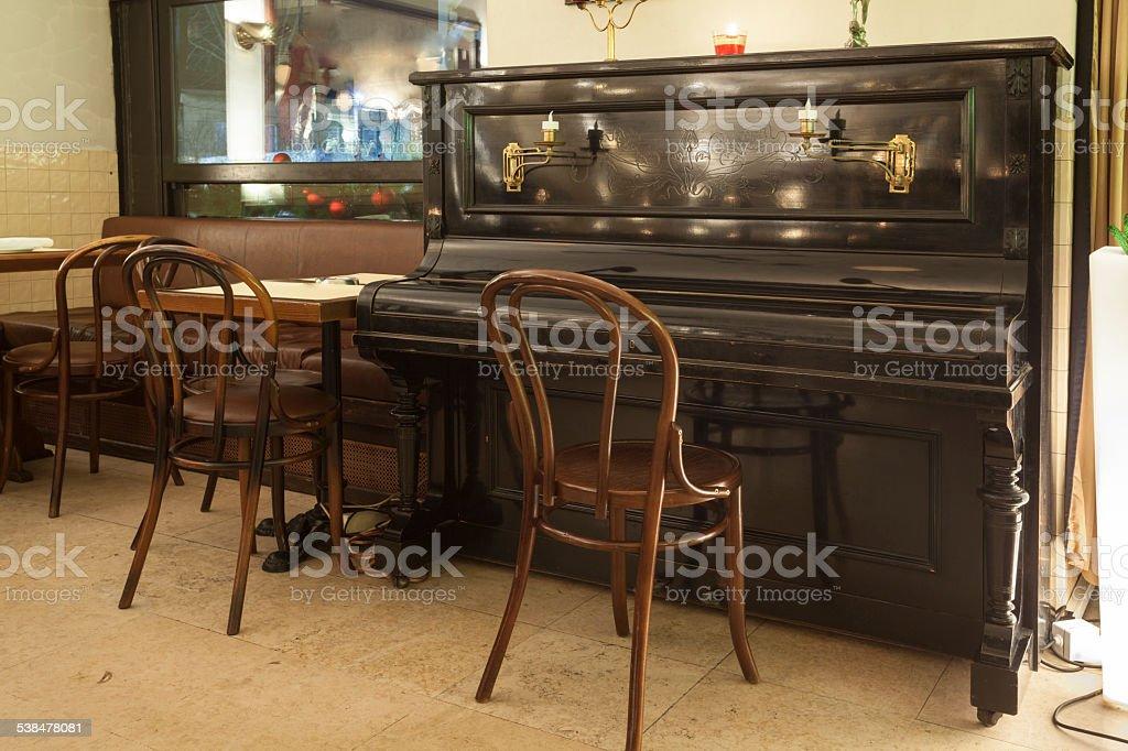 piano in pub interior stock photo