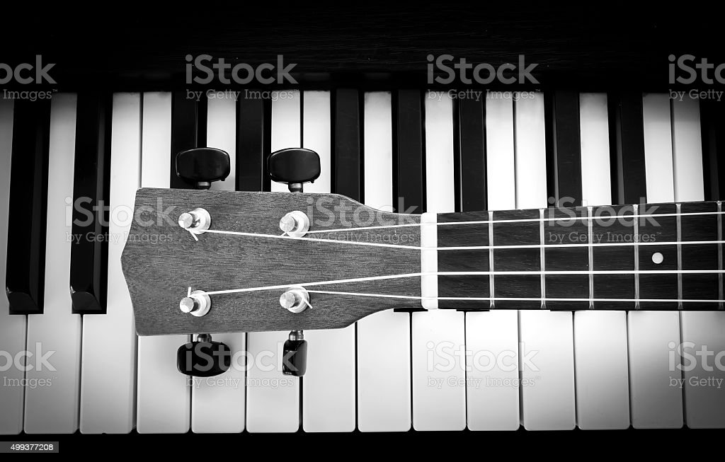 Piano key and ukulele stock photo