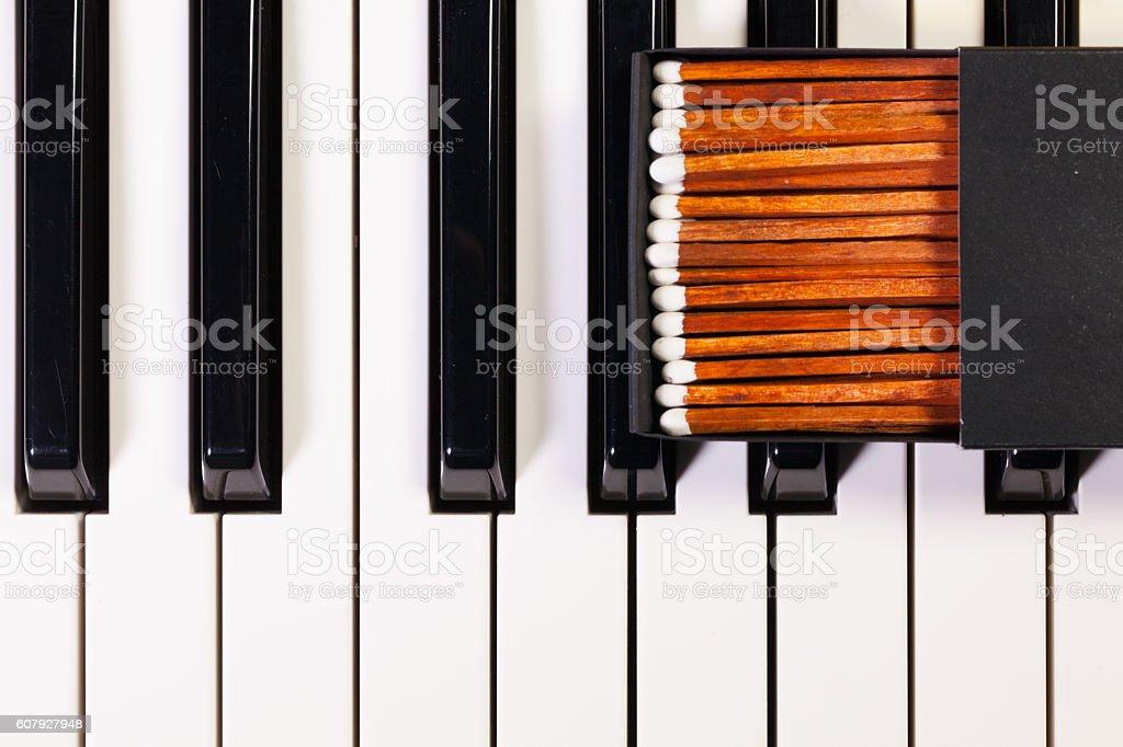 Piano keyboard and luxury matchbox stock photo