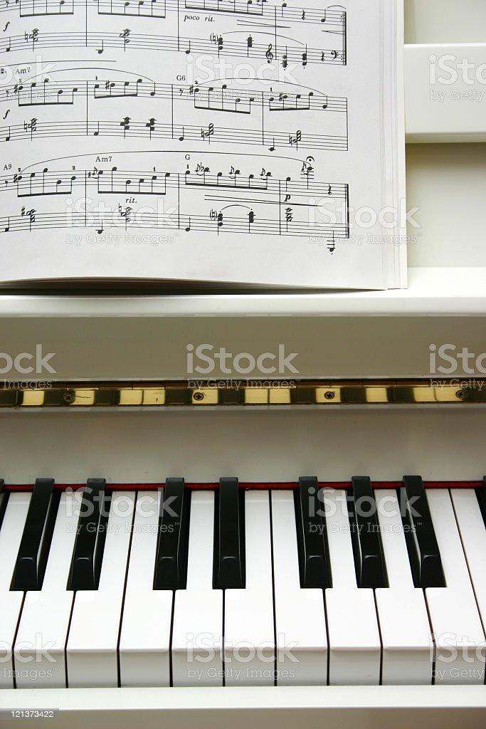 Piano keyboard and music notes royalty-free stock photo