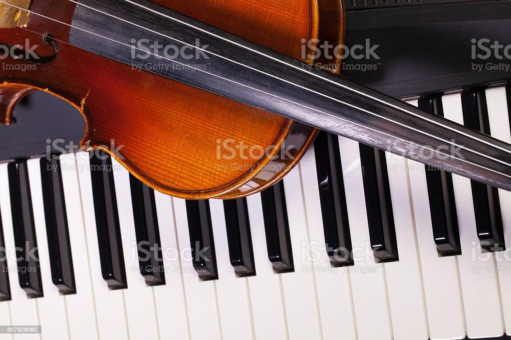 Piano keyboard and old violin stock photo