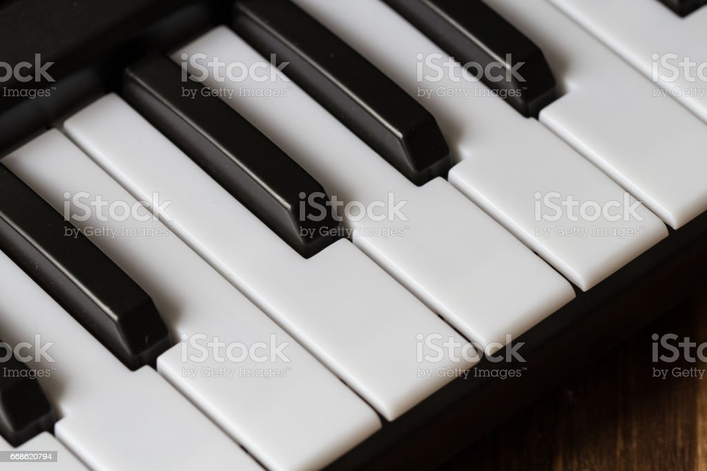 piano keyboard close-up on wooden background stock photo