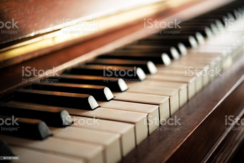 Piano keyboard of an old music instrument, close up stock photo