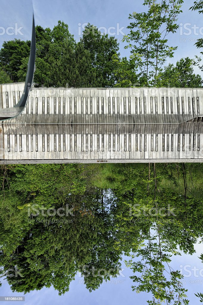 Piano Keyboard Outdoors Floating in Sunny Summer Landscape royalty-free stock photo