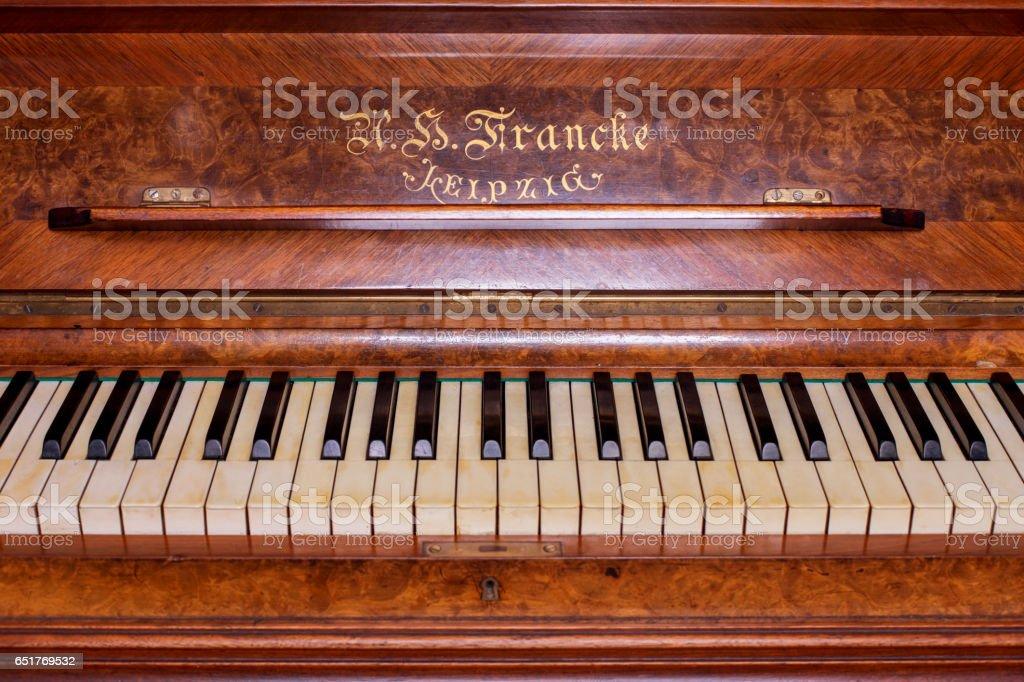 Piano keys of an old German piano stock photo