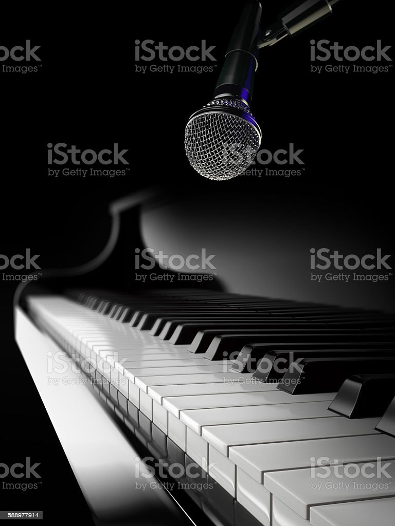 piano keys on black piano with microphone stock photo