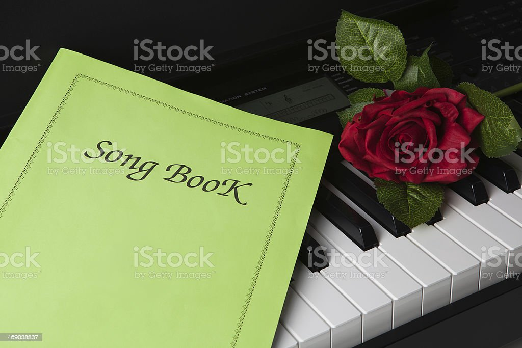 Piano keys, song book,and rose flower royalty-free stock photo