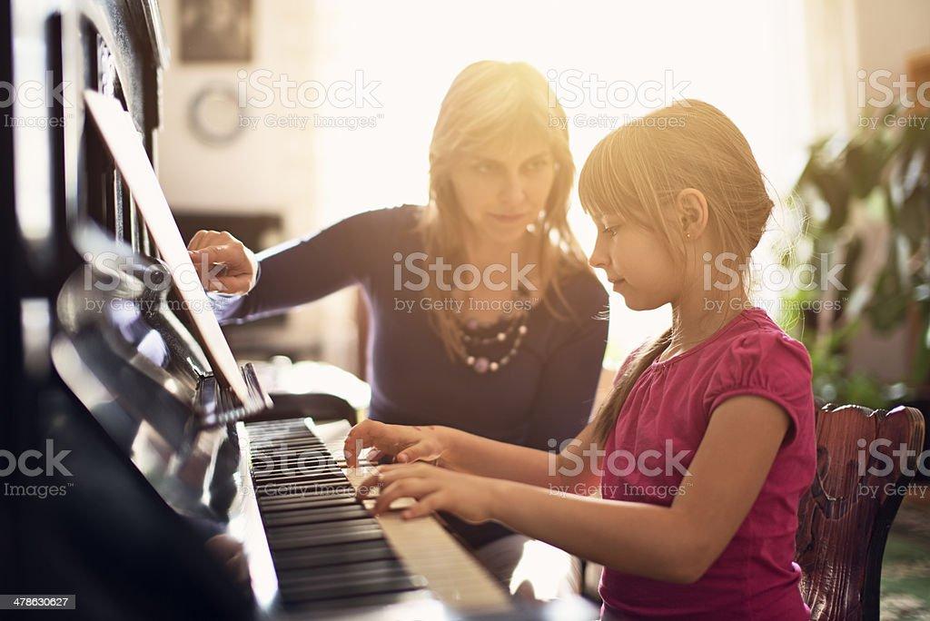 Piano lesson stock photo