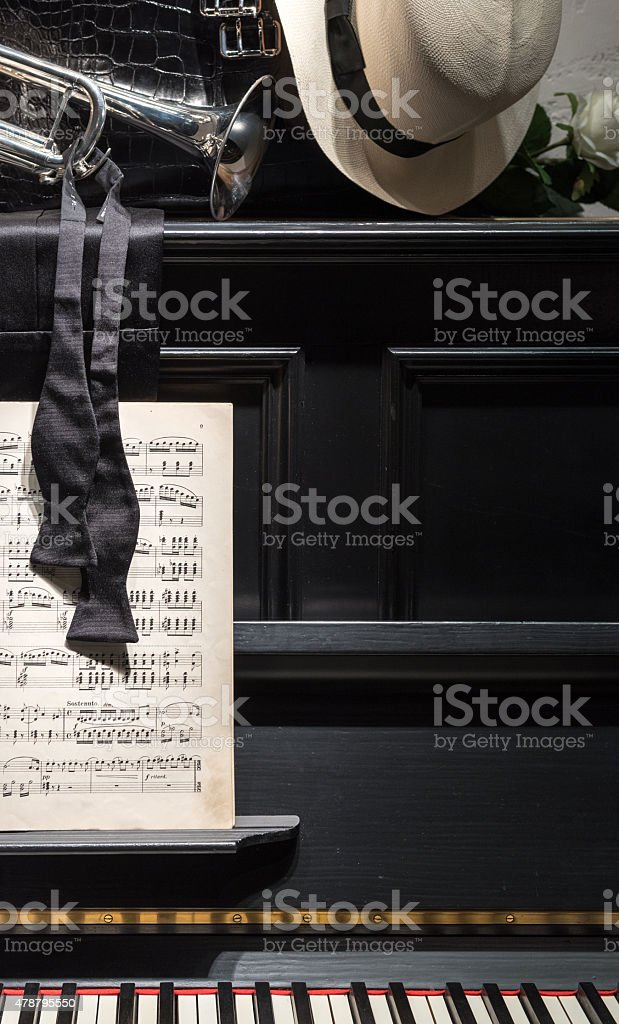 Black Piano with Sheet Music and Bow Tie