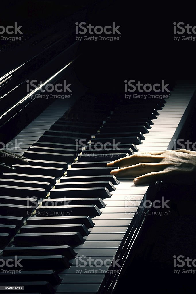 Piano music pianist hand playing. stock photo