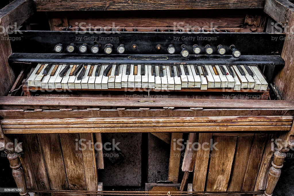 Piano old and worn down stock photo