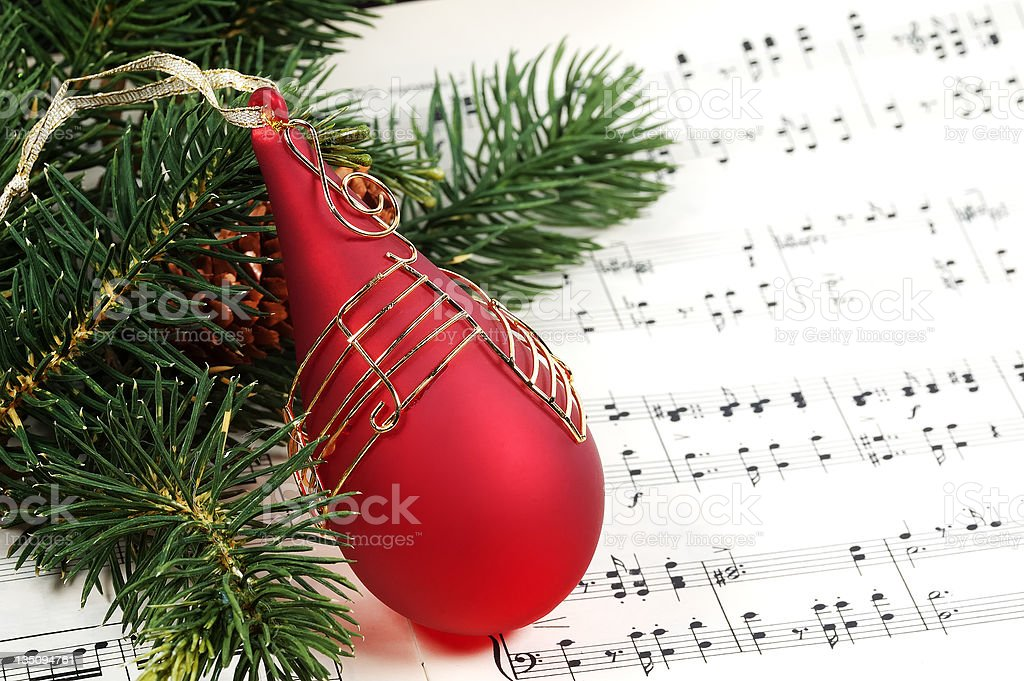 A piano piece of Christmas music with a bauble stock photo