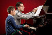 Piano player and his student during lesson