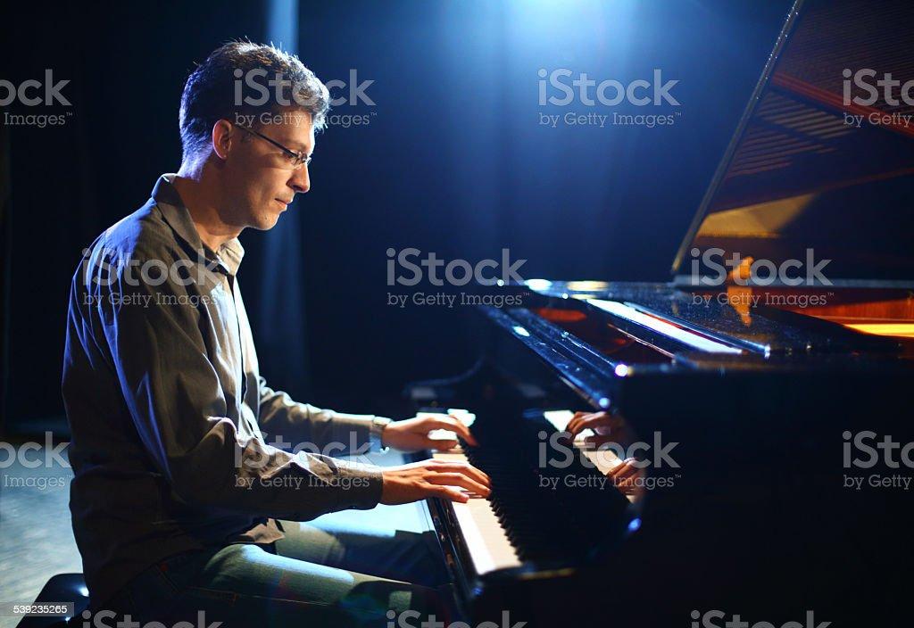 Piano player. stock photo