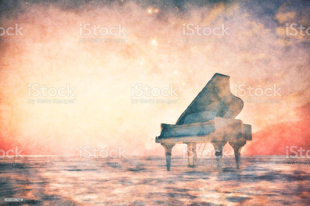 Piano standing in fantasy landscape stock photo