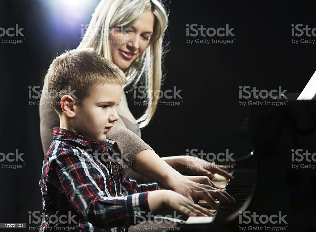 Piano teacher with her student. royalty-free stock photo