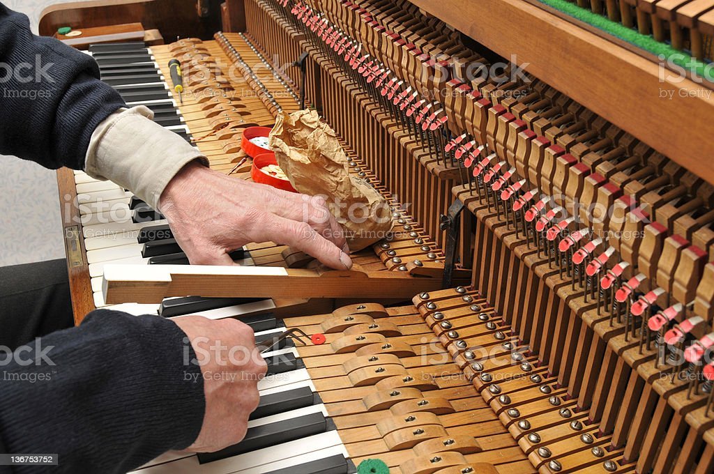 Piano Tuning & Key Adjustment stock photo
