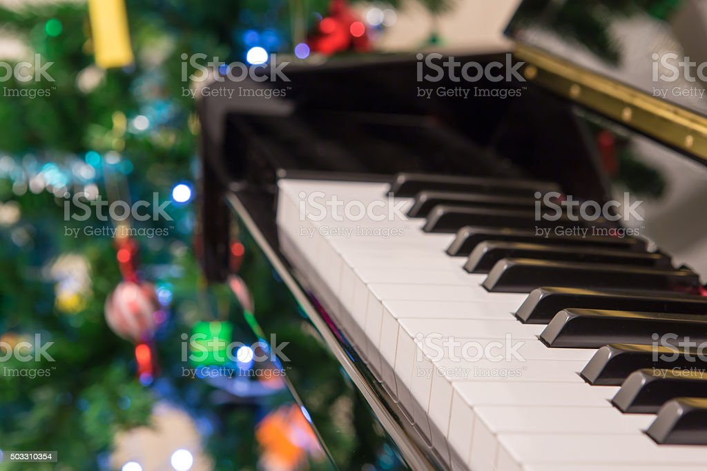 Piano with christmas tree background stock photo