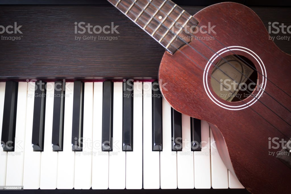 Piano with Ukulele. Art and Music background. Top view. stock photo
