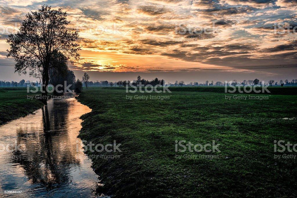 Pianura Padana landscape at sunset, Italy stock photo