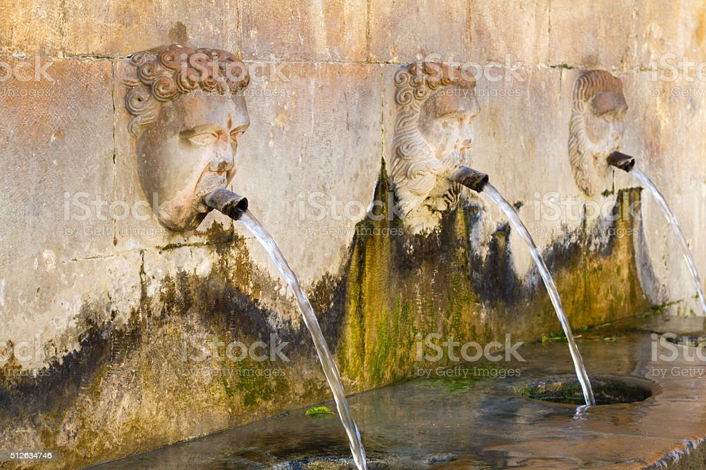 Piazza Armerina, Sicily: Old Water-Laundry Fountain with 3 Carved Spouts stock photo