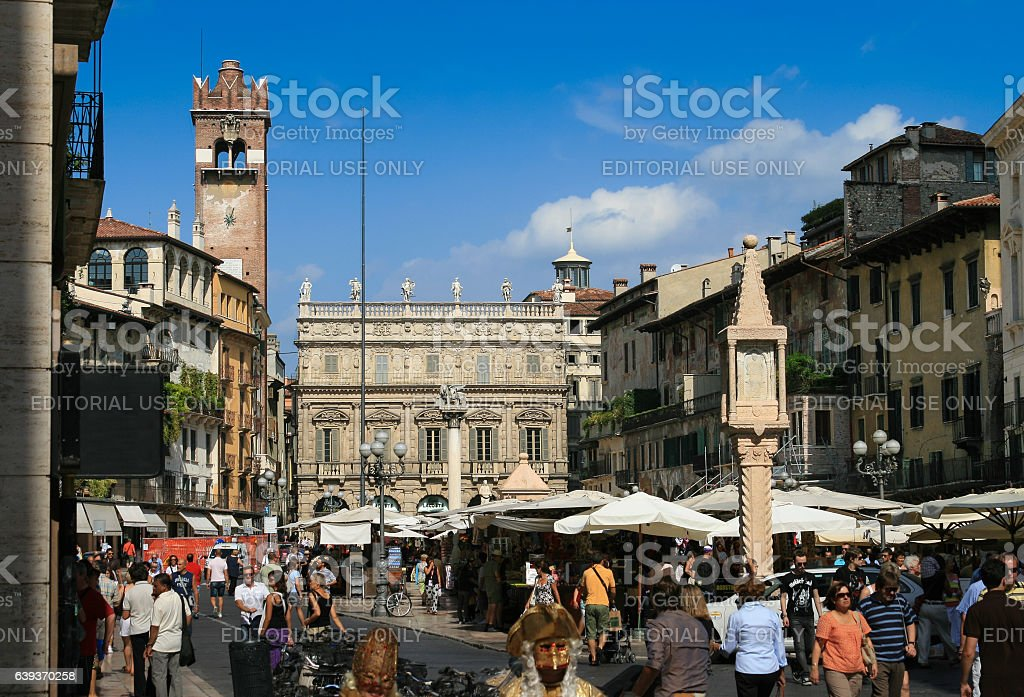 Piazza delle Erbe Full of Sightseeing Tourists, Verona, Italy. stock photo