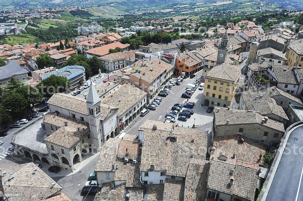 Piazza grande and church of the Suffrage on Borgo Maggiore stock photo