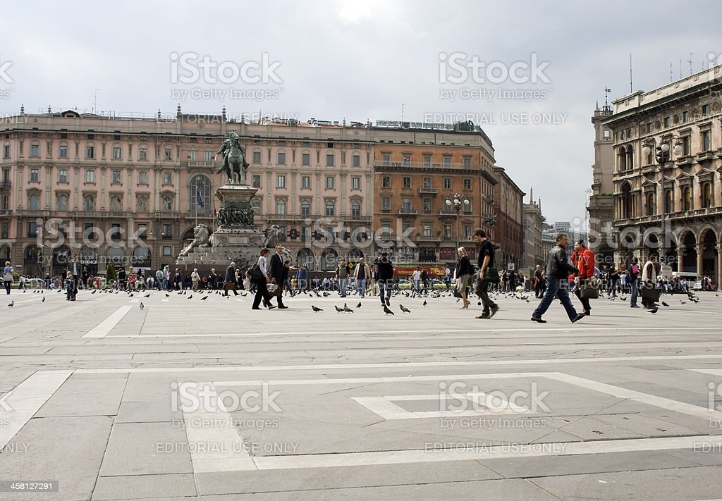 Piazza in Milan full of people walking and sitting royalty-free stock photo