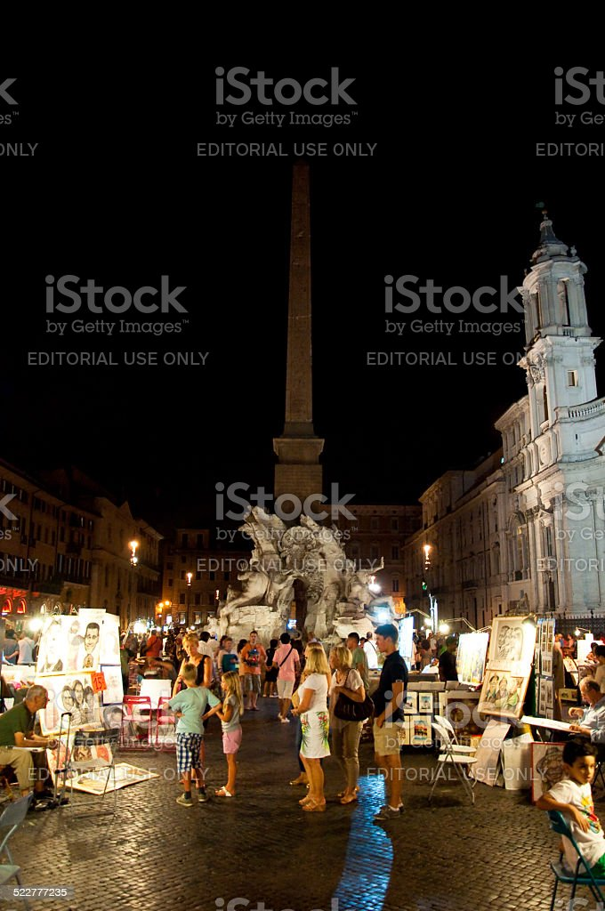 Piazza Navona at night in Rome, Italy. stock photo