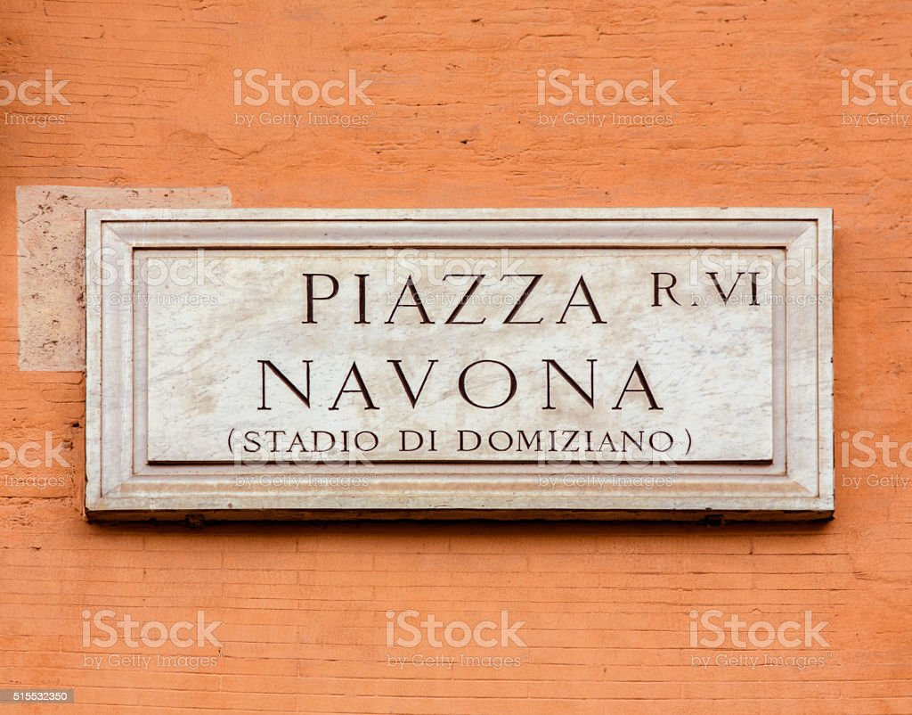 Piazza Navona sign on orange colored wall in Rome, Italy stock photo