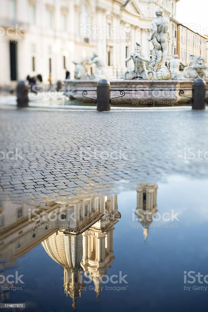 Piazza Navona with puddle and fountain, Rome Italy stock photo