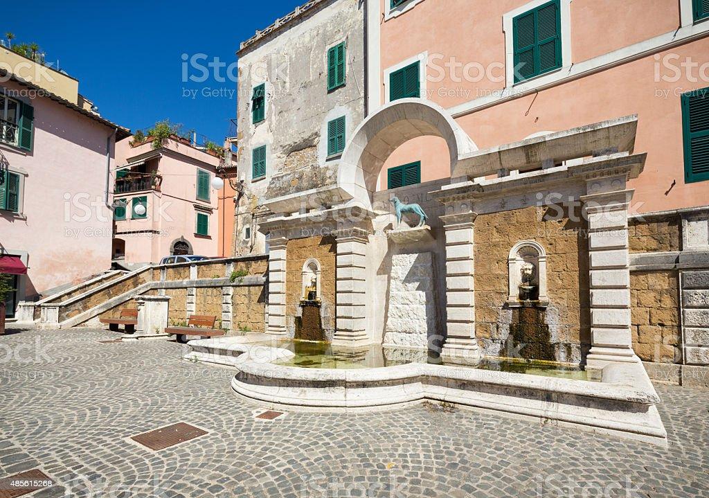 Piazza Vittorio Emanuele with dog fountain in Canino, Lazio Italy stock photo