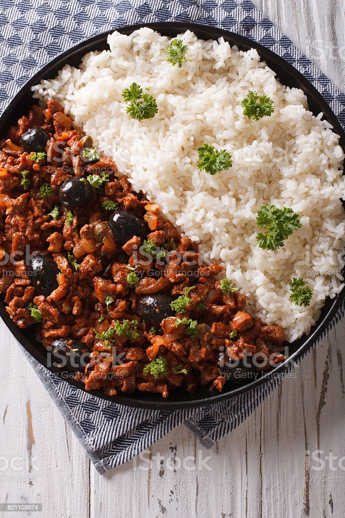 Picadillo a la habanera with rice close-up on the table stock photo