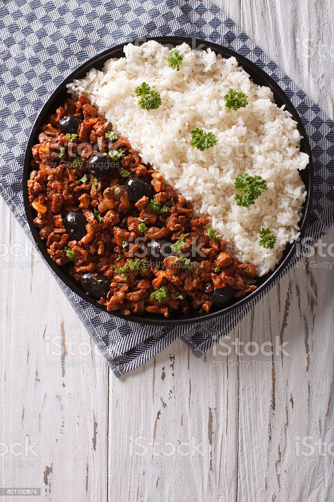 Picadillo a la habanera with rice on table. top view stock photo
