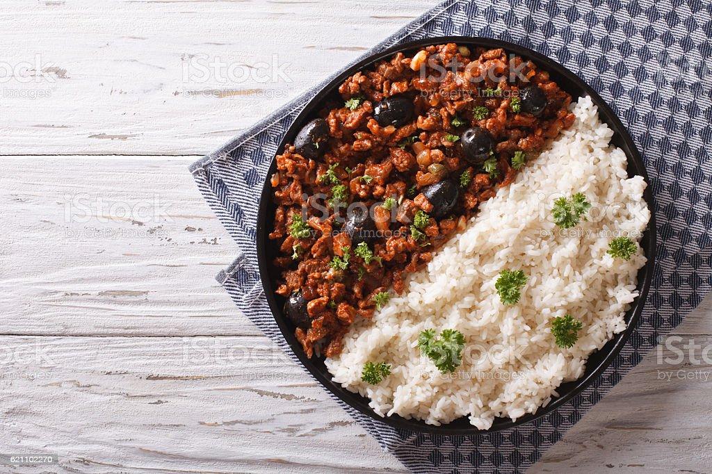 Picadillo a la habanera with rice on the table. Horizontal stock photo