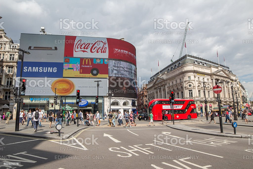 Picadilly Circus in London with double decker bus stock photo