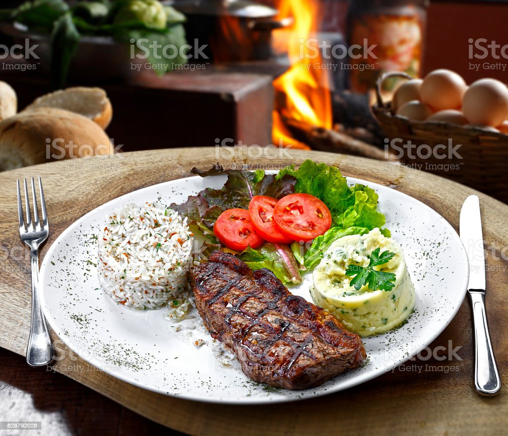 picanha potato with rice and beans drover stock photo