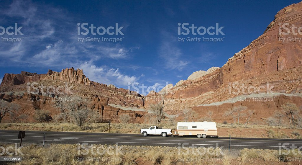 Pick up with mobile home driving in Utah royalty-free stock photo