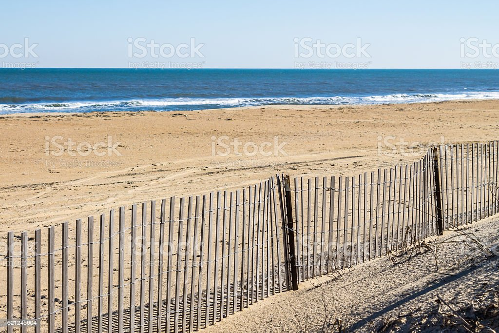 Picket Fence on Empty Sandbridge Beach in Virgnia stock photo
