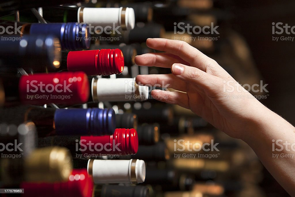 Picking a bottle of wine from the cellar royalty-free stock photo